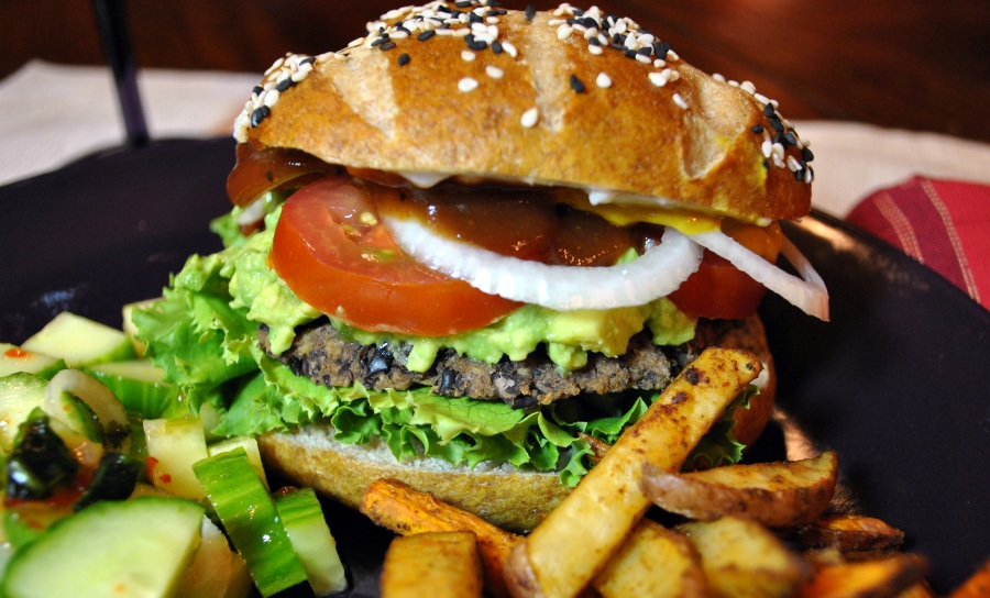 Black Bean Veggie Burger: http://vedgedout.com/2012/10/01/black-bean-veggie-burger-with-guac-on-a-pretzel-bun/